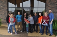 Poteau Chamber members and Sure Stay owners cut ribbon