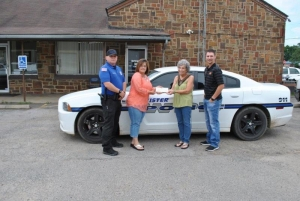 Sergeant Michael Shuttles and Sherry Miller Friends & Family of Wister Police  accepting a donation  from The Community State Bank  Wister Branch Manager Teresa Newby and John Ross Christenberry Wister Branch Lender.