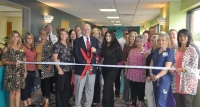 Dr. Nassri and friends share in cutting the ribbon at his new office location at EOMC
