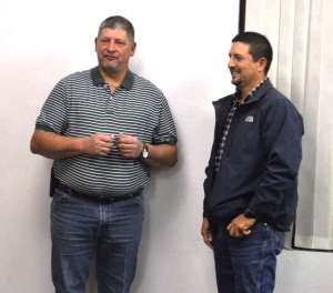 Kevin Adams presents Doug Martinez with his 25-year service pin with the city of Poteau.