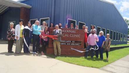 Member of the Community and EOMC employees gathered for the ribbon cutting outside the clinic