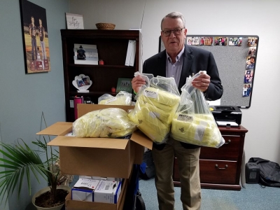Bob Carter, CEO of Eastern Oklahoma Medical Center with the donations from  Carl Albert State College