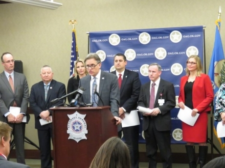 Attorney General Mike Hunter announces the final report and recommendations from the Oklahoma Commission on Opioid Abuse. In background from left, Dr. Layne Subera, Oklahoma Bureau of Narcotics and Dangerous Drugs Control Director John Scully, Sen. AJ Griffin, Rep. Tim Downing, Dr. Kevin Taubman and Oklahoma Department of Mental Health and Substance Abuse Services Director Terri White.