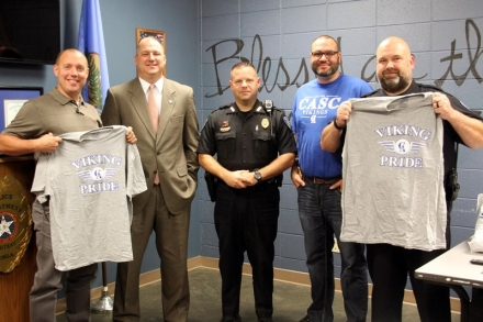 Pictured are Poteau Police Chief Stephen Fruen, Falkner, Poteau Patrolman Kurt Morsund, Brown, and Poteau Lieutenant Gary Ford.